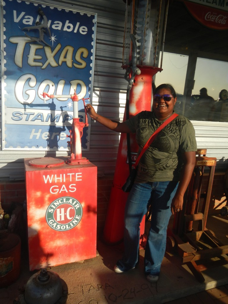 Lauren posing outside of Texas Pride BBQ