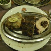 Fig stuffed pork loin, ribs, and chicken