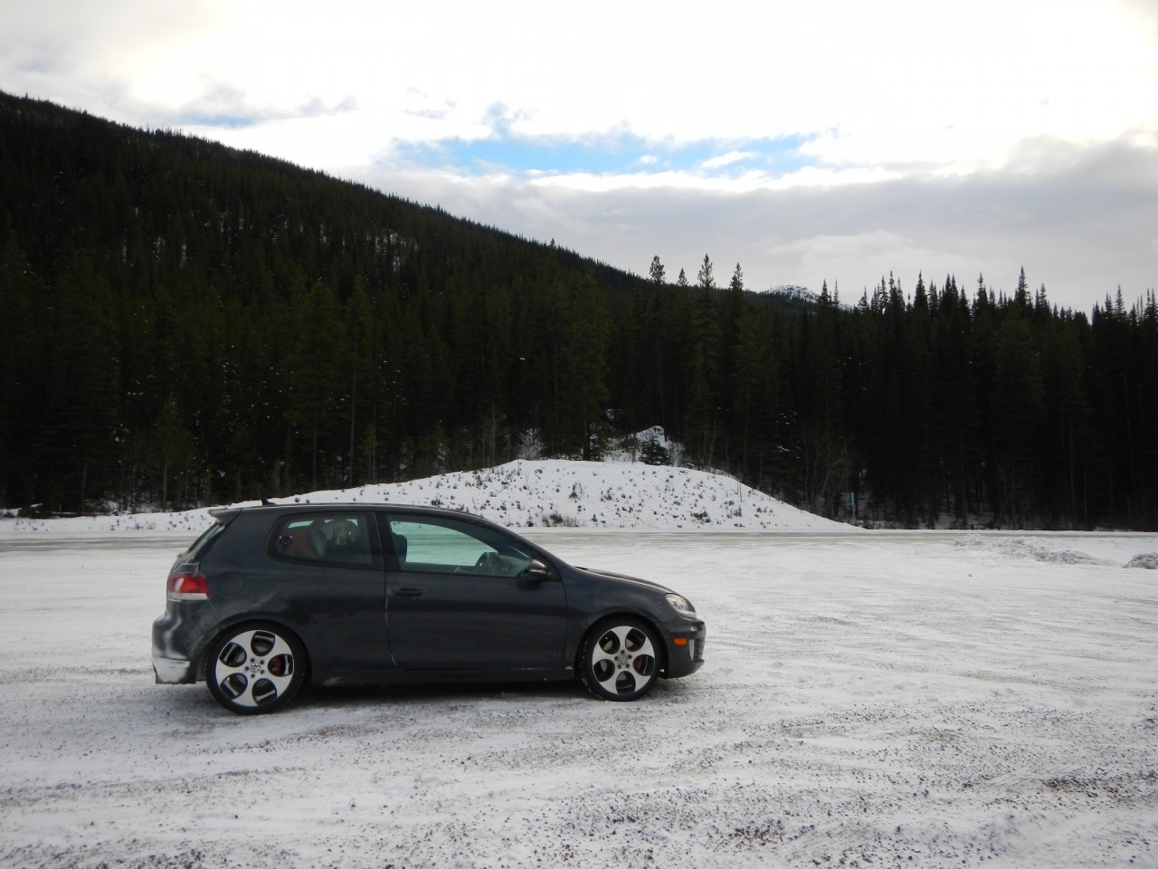 VW GTI parked lakeside in the snow